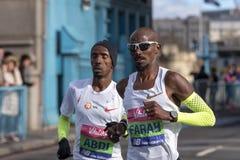 Fonctionnement de Mo Farah et de Bashir Abdi images libres de droits