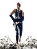 Fonctionnement de nageurs d'athlète d'homme de fer de triathlon d'homme photo libre de droits