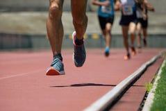 Fonctionnement de personnes d'athlétisme Images libres de droits