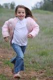 Fonctionnement de petite fille Photographie stock