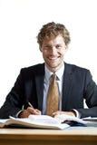 Fonctionnement de sourire d'homme d'affaires Photos stock