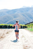Fonctionnement femelle de triathlete Images stock