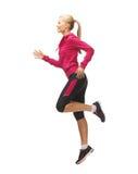 Fonctionnement ou sauter sportif de femme image stock