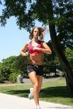 Fonctionnement sportif de femme Image stock