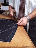 Fonctionner de mains de tailleur. Image libre de droits