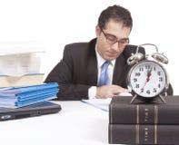 Fonctionner des heures supplémentaires Image libre de droits
