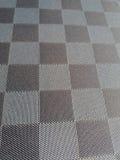 Fond à carreaux gris Image stock