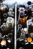 Fond abstrait assorti de bouteilles. Images stock