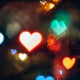Fond abstrait avec Bokeh dans la forme des coeurs Images stock