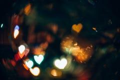 Fond abstrait avec Bokeh dans la forme des coeurs Photo stock