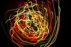 Fond abstrait avec des lignes de lumières de mouvement Images stock