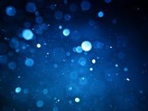 Fond abstrait avec le bokeh de bulle dans la couleur bleue Photographie stock libre de droits