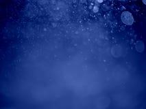 Fond abstrait avec le bokeh de bulle dans la couleur bleue Photo libre de droits