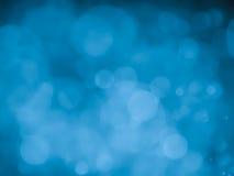 Fond abstrait avec le bokeh de bulle dans la couleur bleue Image stock
