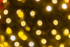 Fond abstrait brouill? des lumi?res de No?l Boules et lignes jaune-orange rougeoyantes brillamment Configurations abstraites de c images libres de droits