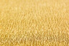 Fond abstrait d'or avec la tache floue Images stock