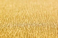 Fond abstrait d'or avec la tache floue Image libre de droits