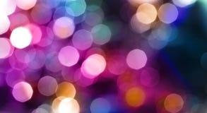 Fond abstrait de clignotement de tache floue de lumières de ville Images stock