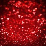 Fond abstrait de coeurs rouges lumineux Photos libres de droits