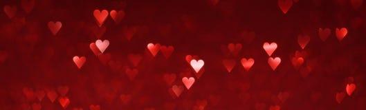 Fond abstrait de coeurs rouges lumineux Images libres de droits