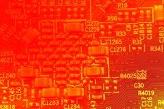 Fond abstrait de couleurs rouges de carte PCB Photographie stock libre de droits