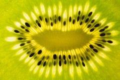 Fond abstrait de la tranche mûre de kiwi Photos libres de droits