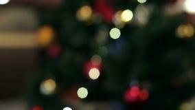 Fond abstrait de Noël avec les lumières Defocused Fond de Noël, bokeh banque de vidéos
