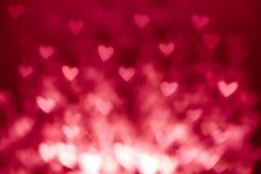 Fond abstrait de Saint-Valentin avec les coeurs rouges Coloré ainsi Photographie stock libre de droits