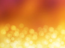 Fond abstrait de tache floue de bokeh d'or de lumière d'effet Photos stock