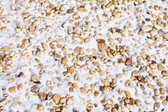 Fond abstrait de texture d'hiver de neige et de pierres Photographie stock