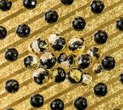 Fond abstrait des perles noires Photographie stock libre de droits