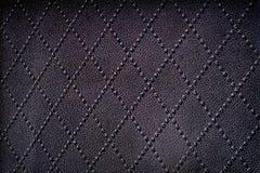 Fond abstrait en cuir véritable noir sans couture de modèles images stock