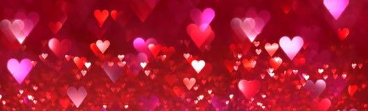 Fond abstrait lumineux de coeurs rouges et roses Image stock