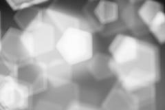 Fond abstrait noir et blanc, bokeh brouillé de lumières Photographie stock libre de droits