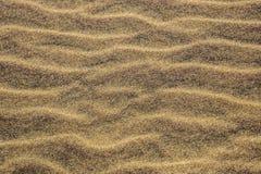 Fond abstrait : Ondulations en sable Photos stock