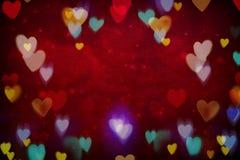 Fond abstrait rouge de jour du ` s de Valentine avec des coeurs photographie stock libre de droits