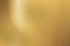 Fond abstrait, texture en acier balayée de mur d'or photographie stock