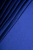 Fond abstrait, tissu de bleu de draperie. Photographie stock libre de droits