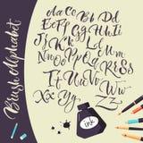 Fond artistique avec des stylos et l'alphabet d'encre Images stock