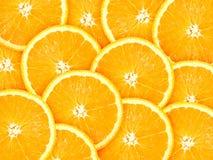 Fond avec des agrumes des parts oranges Photographie stock libre de droits