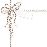 Fond avec l'arc et les rubans de ficelle de boulangers Images stock