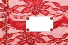 Fond avec la décoration et le lacet rouges Photographie stock