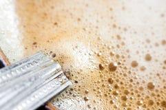 Fond avec la mousse de café Photographie stock