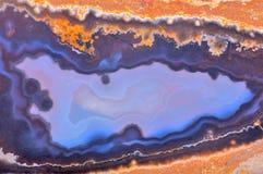 Fond avec la structure bleu-foncé et orange d'agate Photographie stock libre de droits