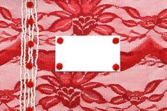Fond avec le lacet et la fleur rouges Photographie stock