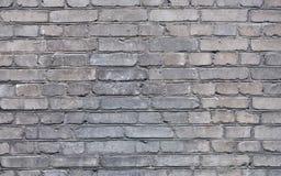 Fond avec les briques grises Images stock