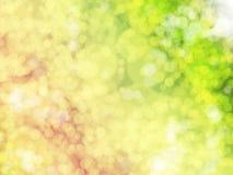 Fond avec les lumières lumineuses en jaune, vert et orange Photos stock