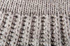 Fond avec un tissu tricoté Photos libres de droits