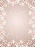 Fond beige avec des flocons de neige Photo stock