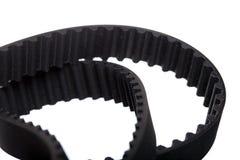 Fond blanc d'isolement de moteur de voiture de ceinture Images libres de droits